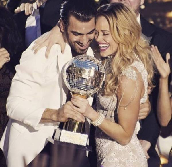 Image Nyle DiMarco and his partner as they won the trophy on Dancing with the Stars