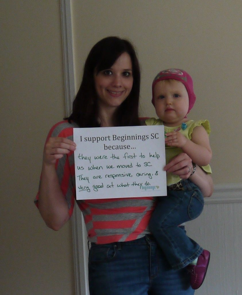 """Mom and baby holding sign reading """"I support Beginnings SC because..."""""""