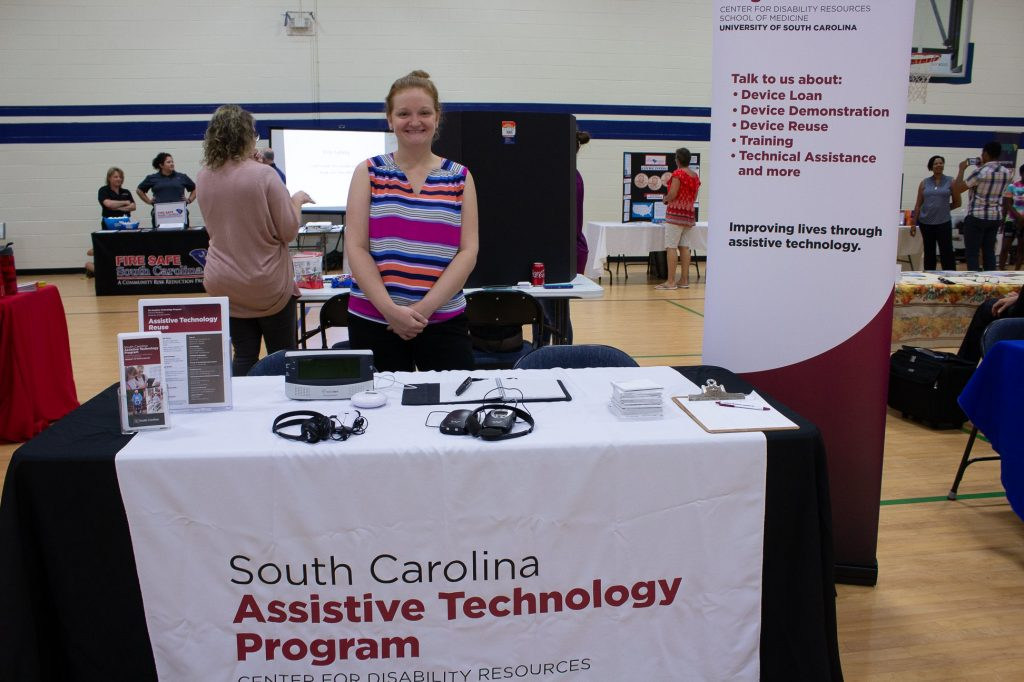 Representative from SC Assistive Technology Program stands at her booth.